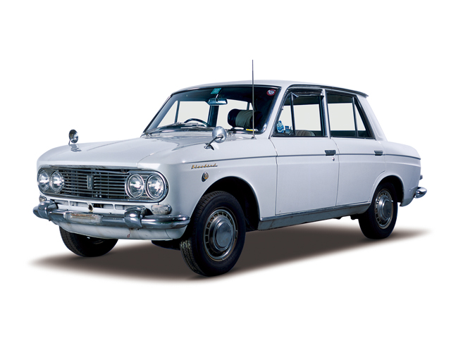1964 Bluebird 1200 Deluxe - Máy E1 (4-cyl. in line, OHV), 1,189cc, 40kW (55PS)